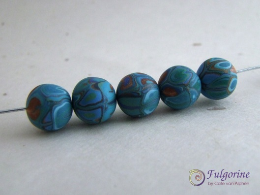Aqua and copper patchwork beads by Cate van Alphen