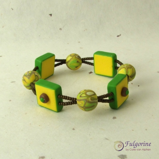 Yellow bead bracelet by Cate van Alphen